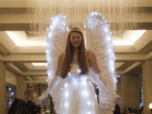 Angel stilt walker with giant feather wings