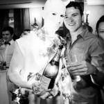Illuminated statue serving champagne