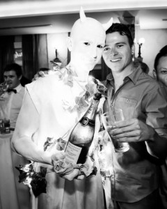 Illuminated statue serving champagne