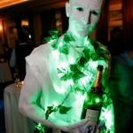 Dark Angel statue serving champagne