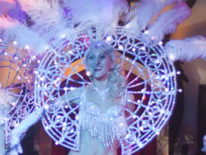 showgirl dance routine with self-illuminated light backpieces